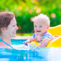 Mother and child in pool.